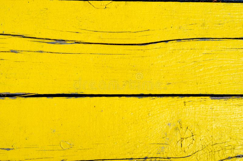 Colorfull  rusty   yellow painted wooden timber  wall stock photo