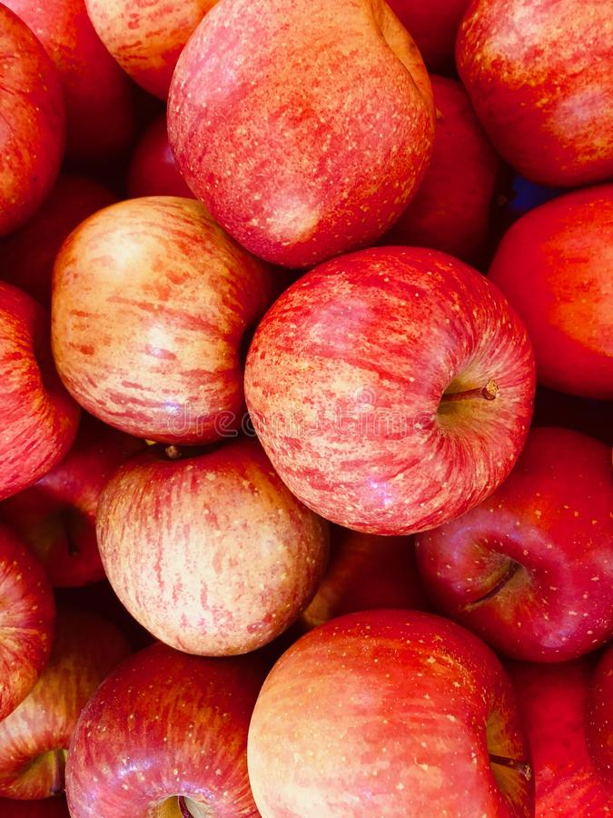 Full frame of texture, Group of Apple For Sale At Market. The fruit of apples is rich in minerals and vitamins and is one of the most commonly eaten fruits royalty free stock image