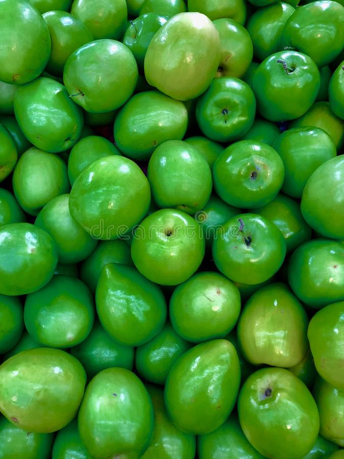 Full frame of texture, Group of Jujube For Sale At Market. Candied dates, shaped like green apples stock image