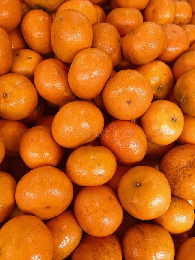Full frame of texture, Group of Orange citrus For Sale At Market. Full frame of texture, Group of Orange For Sale At Market.Winter is the season of citrus stock photo