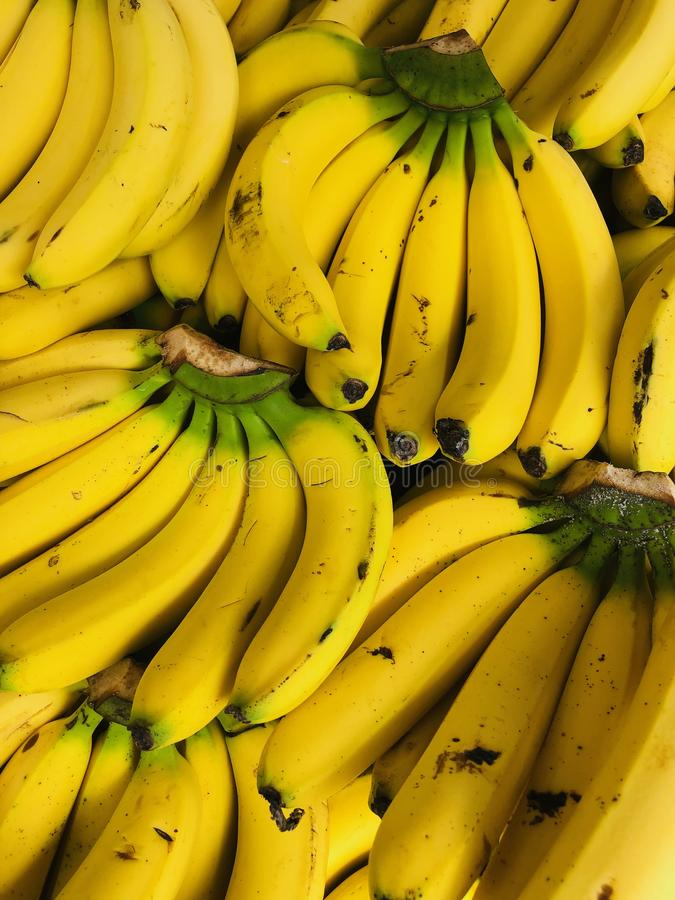 Full frame of texture, Group of Yellow Bananas For Sale At Market. Eating bananas often prevents high blood pressure because bananas provide more potassium royalty free stock image