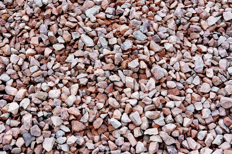 Full frame view of small broken pieces of stone. Overhead, full frame view of small broken pieces of stone, for use as background image stock photography