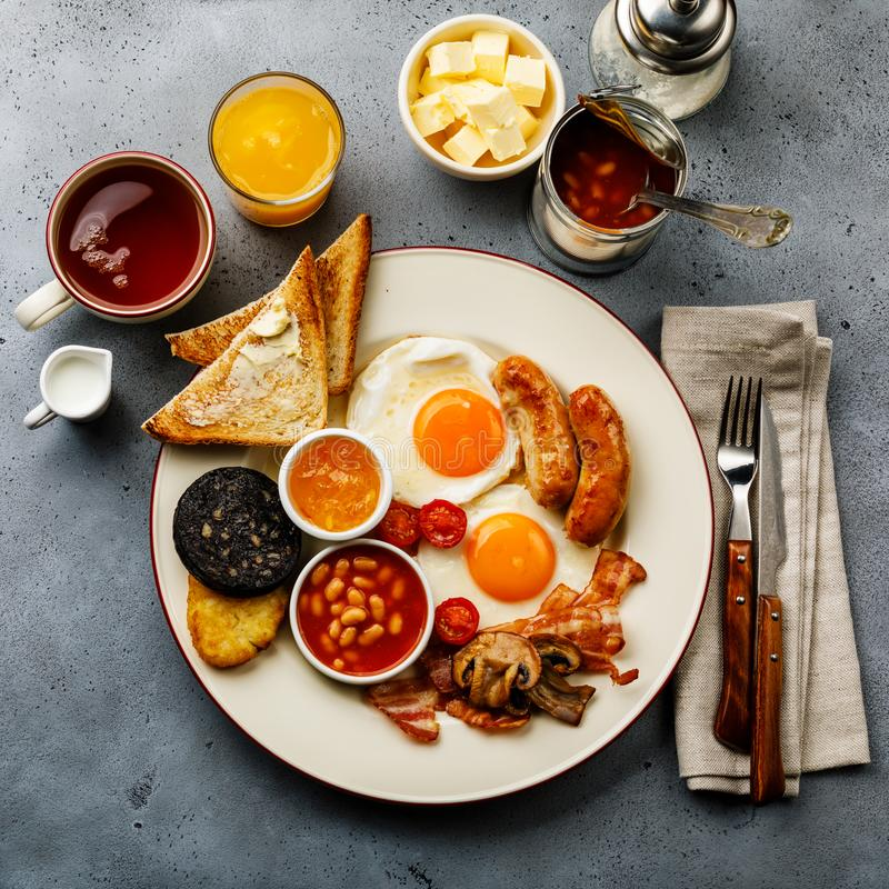 Full fry up English breakfast with fried eggs, sausages, bacon royalty free stock image
