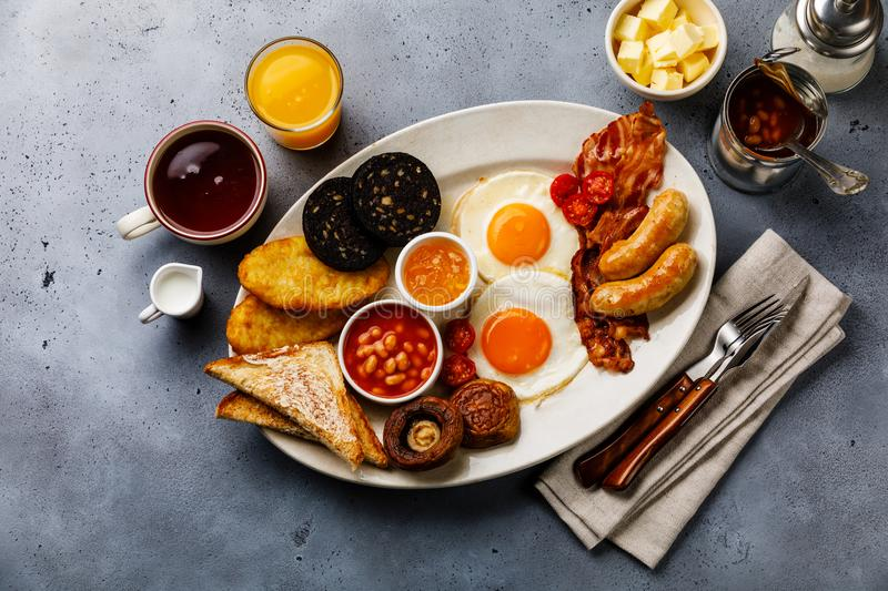 Full fry up English breakfast with fried eggs, sausages, bacon stock photography
