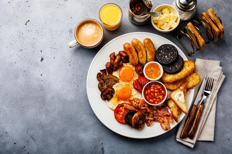 Full fry up English breakfast with fried eggs, sausages, bacon royalty free stock photo