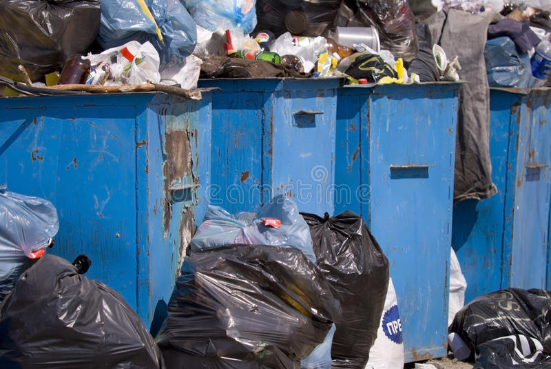 Full garbage containers. Clogged garbage dumpsters within the boundaries of a city stock photography
