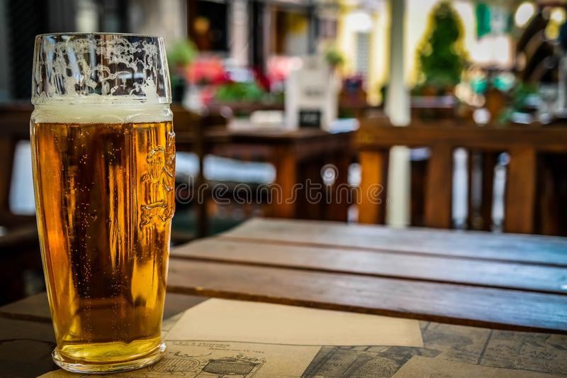 Full glass of beer on the table stock images