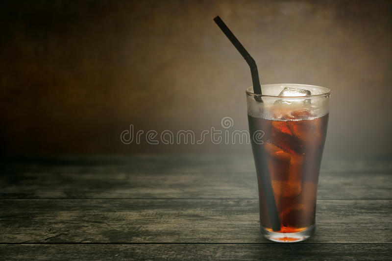 Full glass of cola. With iced royalty free stock photography