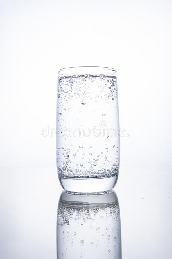 Full glass cup with carbonated pure mineral water royalty free stock photos