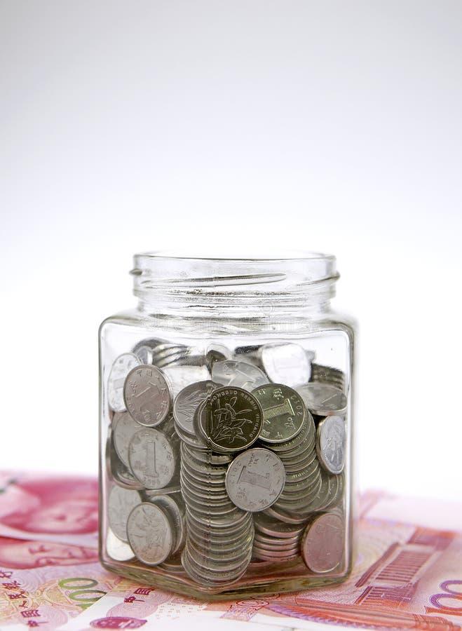 full glass jar för mynt royaltyfria foton