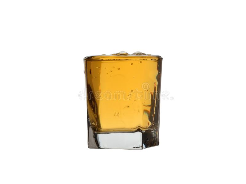 Full glass of whiskey with bubbles and drops isolated on white background royalty free stock photos