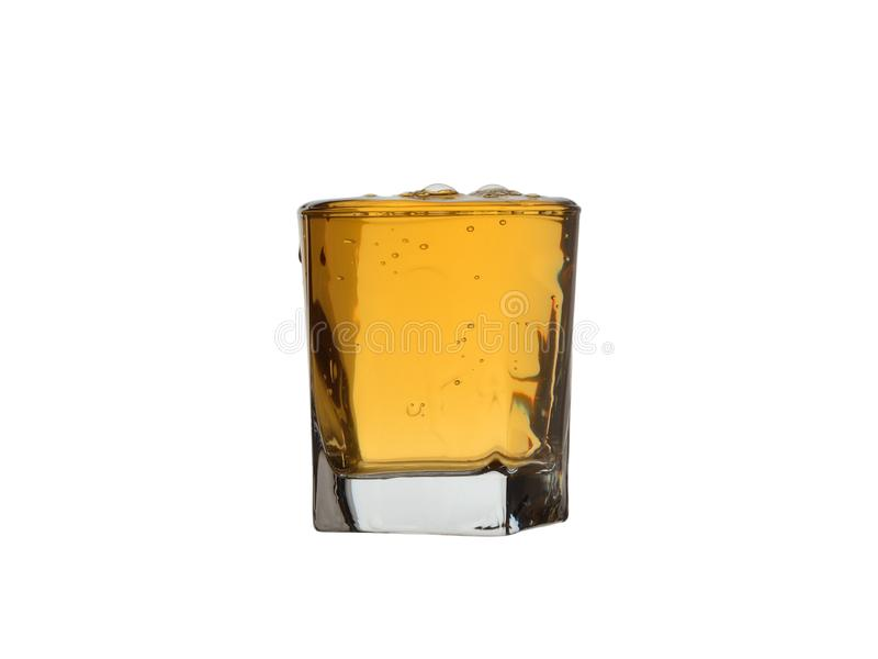 Full glass of whiskey with bubbles and drops isolated on white background stock photo
