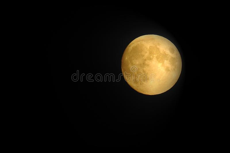 Full Golden July Moon Buck Moon 2019. The full July Buck Moon of 2019 rising in UK skies royalty free stock photography