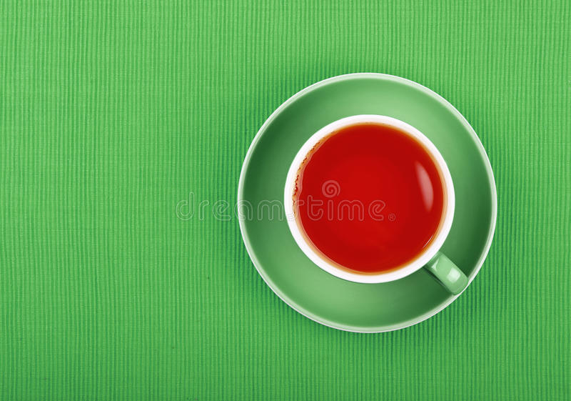 Full green tea in blue cup close up top view stock photos