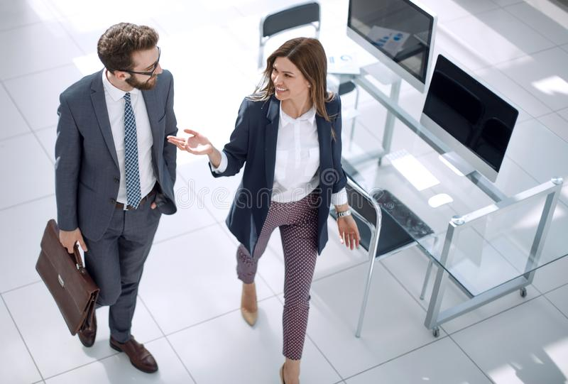 In full growth.business colleagues standing near the desktop royalty free stock image