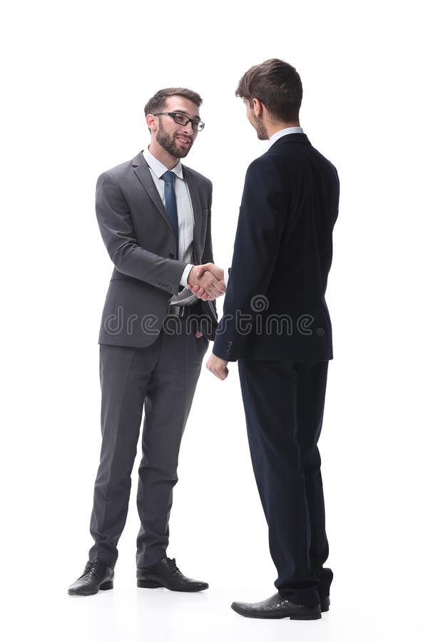 In full growth. business people shaking hands royalty free stock photo