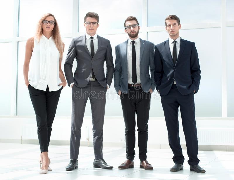In full growth. business team standing in the office. royalty free stock photo
