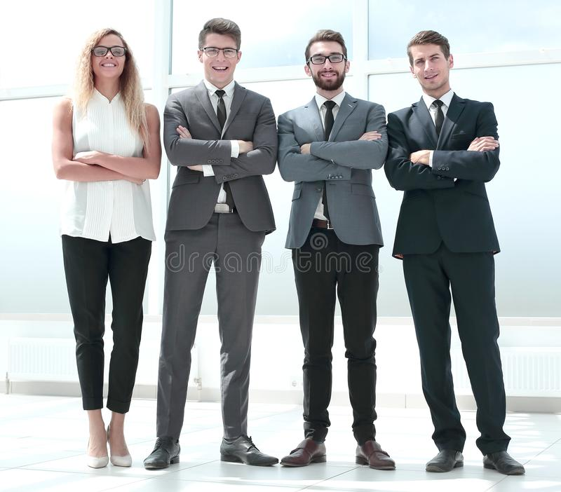 In full growth. business team standing in the office. stock images
