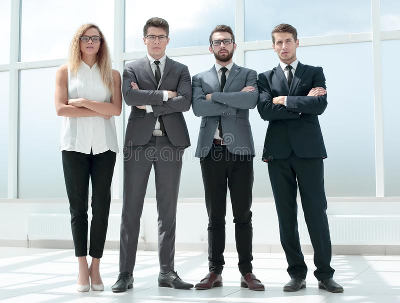 In full growth. business team standing in the office. royalty free stock photos