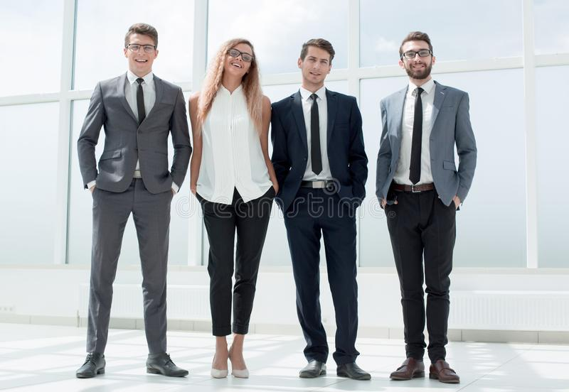 In full growth. business team standing in the office. stock photo