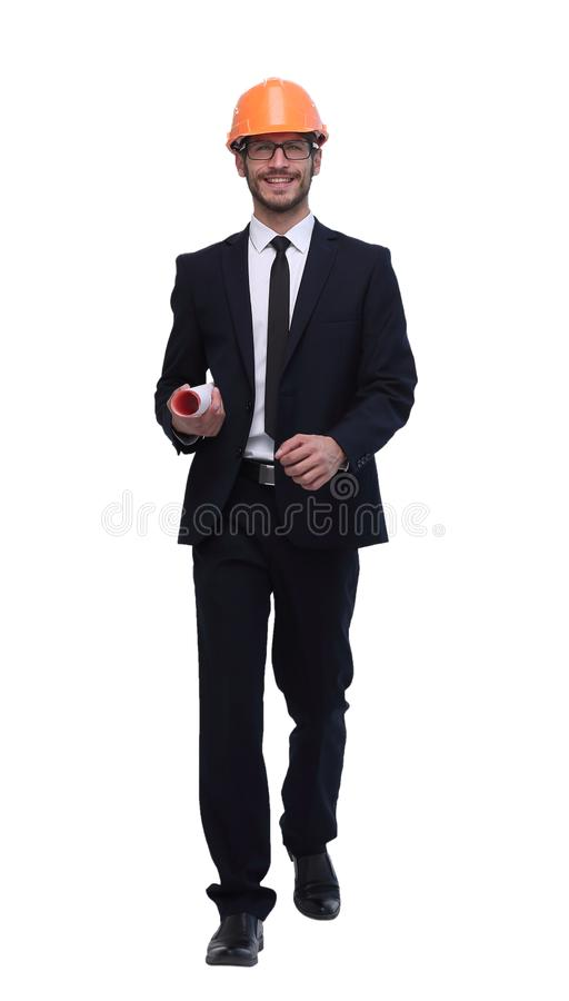 In full growth. businessman with sketches for a new project. Isolated on white background stock image