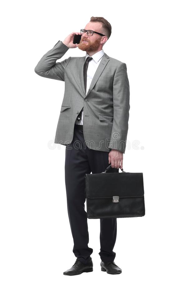 Confident businessman with briefcase . isolated on white background royalty free stock images