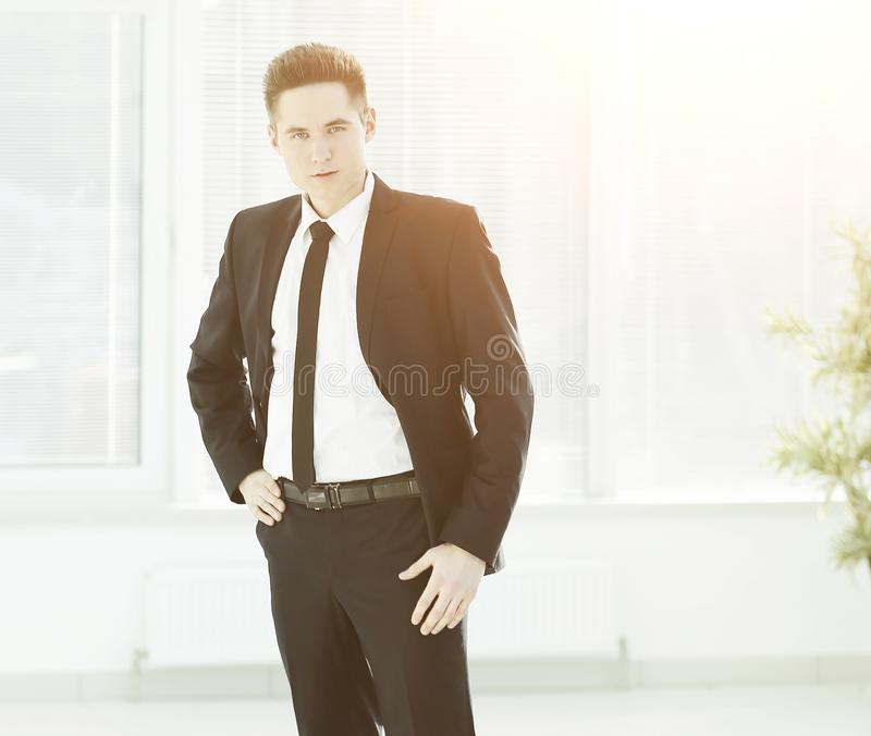 Full growth.confident young businessman standing in office. royalty free stock images