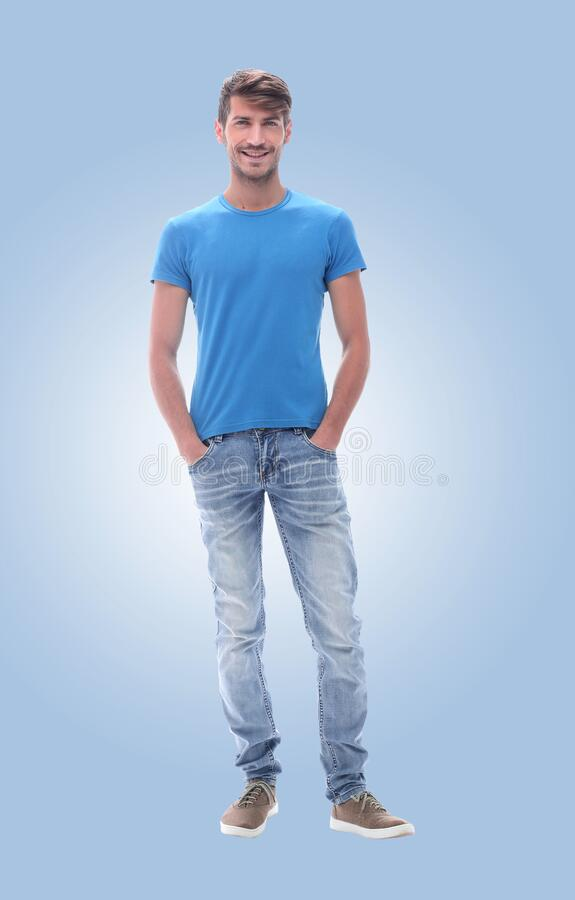 In full growth. confident young man in jeans. royalty free stock image