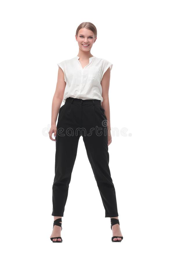 Confident young woman leader stepping forward. isolated on white. In full growth. confident young woman leader stepping forward. isolated on white background stock photography