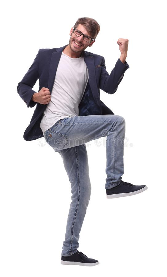 In full growth.dancing happy business man stock photo