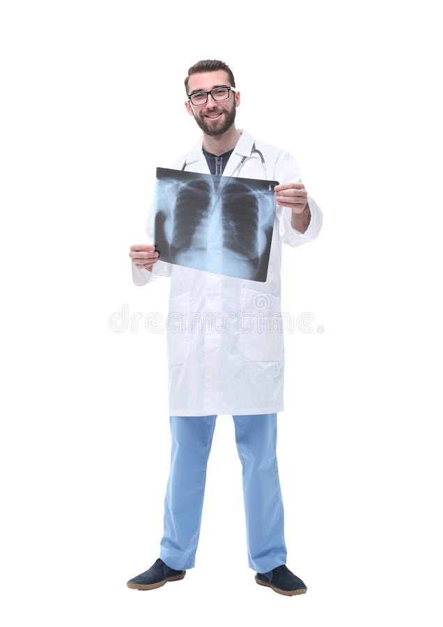 In full growth. doctor therapist looking at the x-ray royalty free stock photos