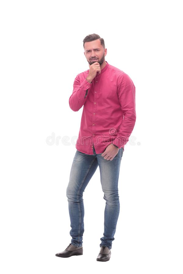 In full growth. doubting young man pointing at you royalty free stock photos