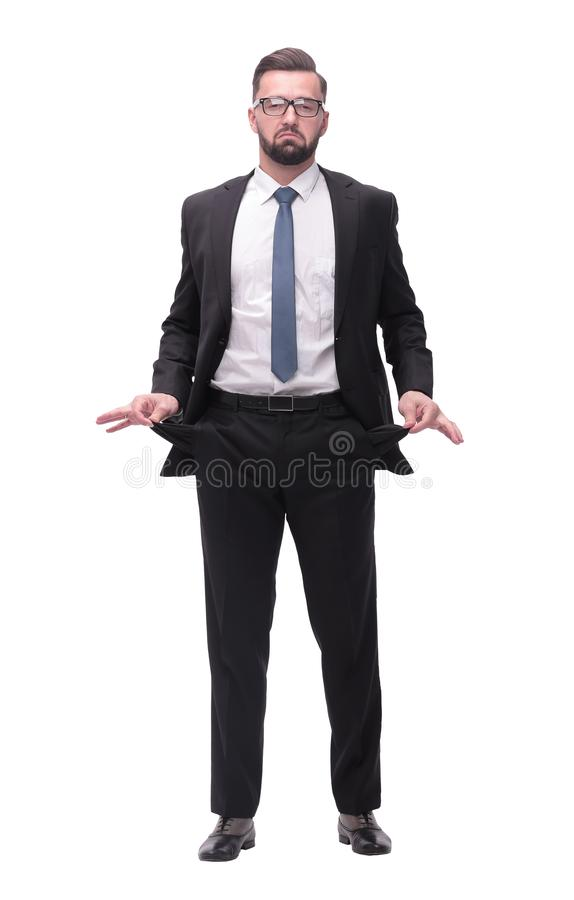 In full growth. frustrated businessman showing his empty pockets stock photography