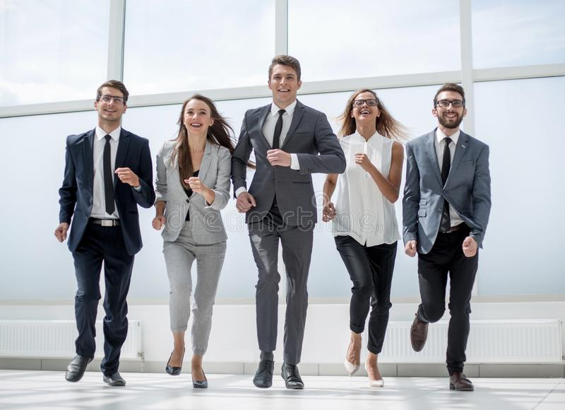 In full growth.a group of business people walking together. royalty free stock photos
