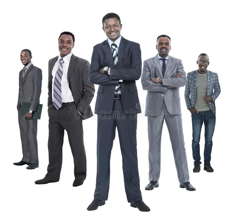 In full growth.leader standing in front of his business team. Isolated on white background royalty free stock image