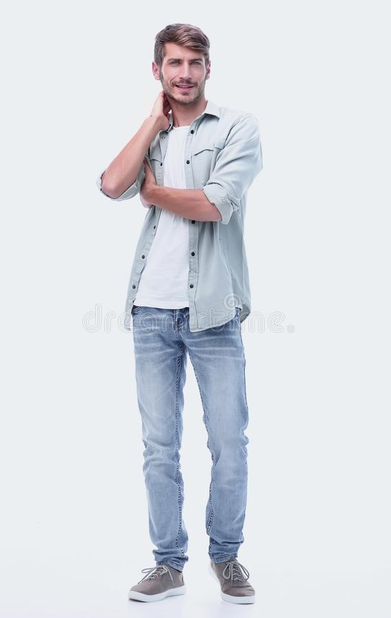 In full growth. modern young man in jeans stock image