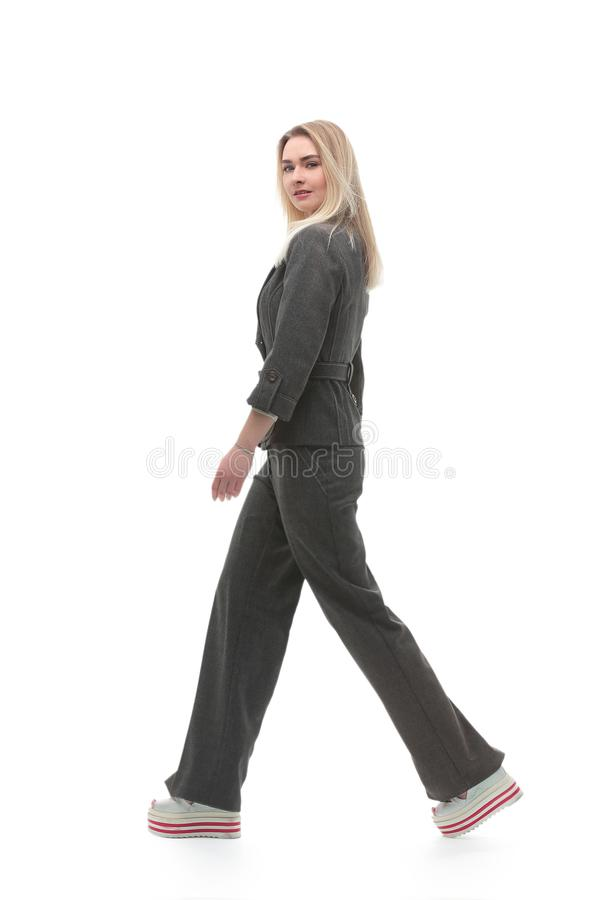 Full growth.motivated business woman walking forward. stock photography