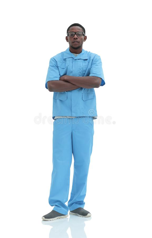 In full growth. portrait of a confident young doctor surgeon royalty free stock image
