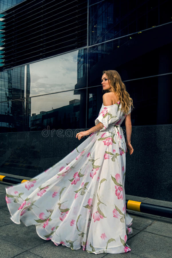 Full growth portrait of fashionable woman on urban background stock images