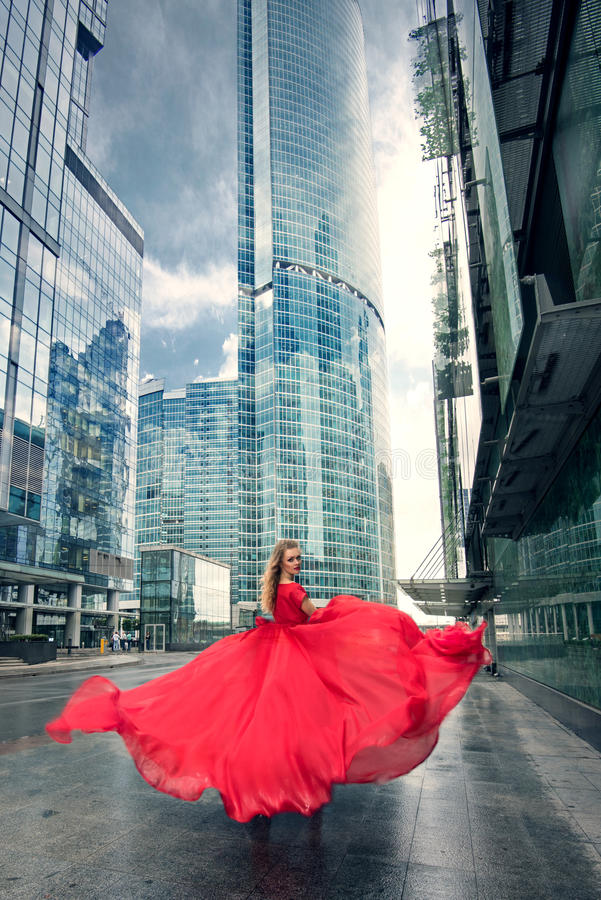 Full growth portrait of fashionable woman on urban background stock image