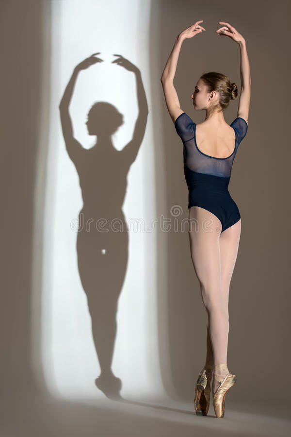 Full growth portrait of the graceful ballerina in stock images