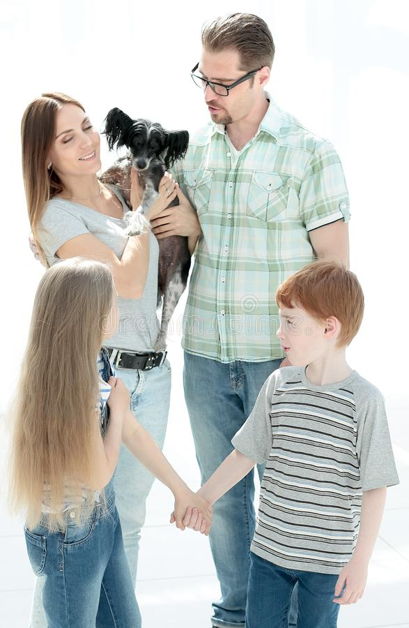 Portrait of a happy family with a pet stock photography