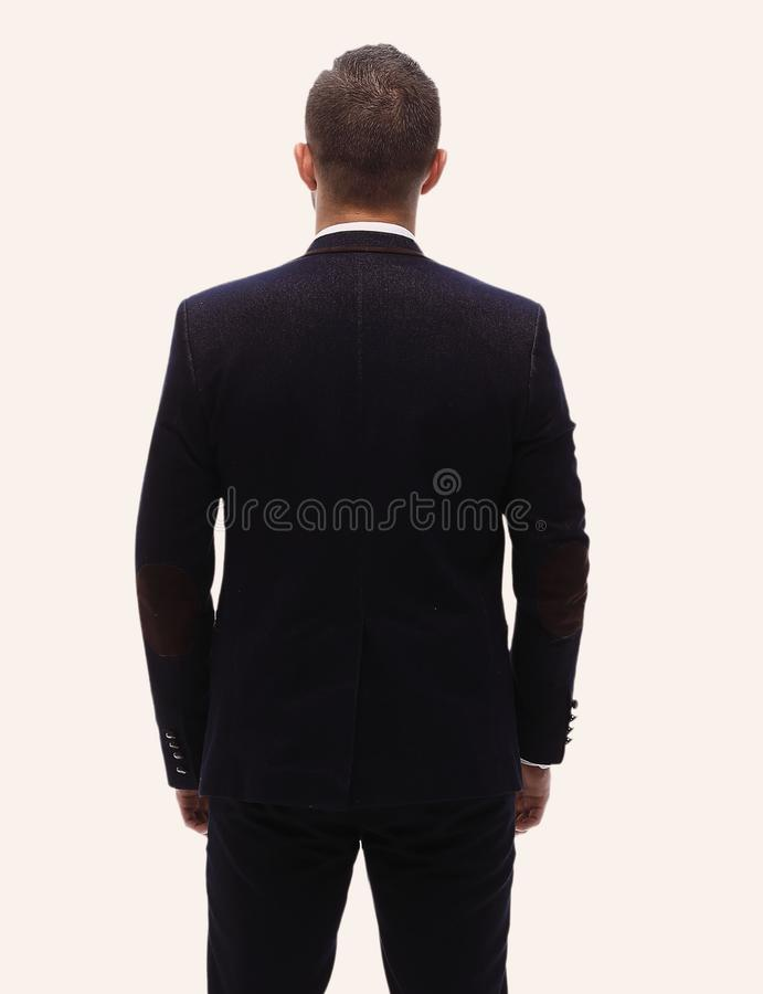 In full growth.rear view of a successful businessman. royalty free stock photos