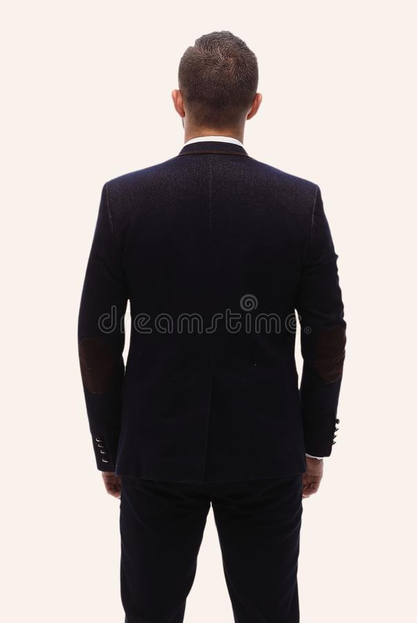 In full growth.rear view of a successful businessman. stock images