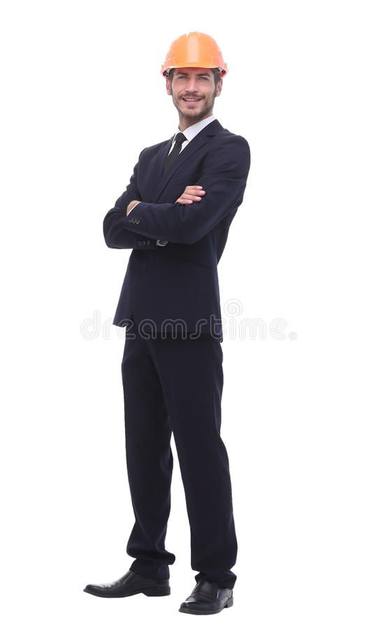 In full growth. a serious businessman in a protective helmet. Isolated on white background stock photography