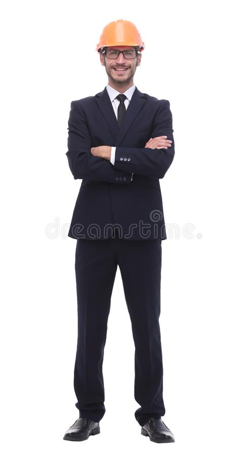 In full growth. a serious businessman in a protective helmet. Isolated on white background royalty free stock photos