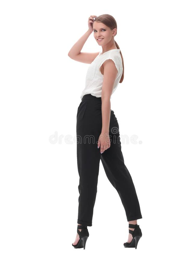 Serious confident business woman looking at camera. isolated on white. In full growth. serious confident business woman looking at camera. isolated on white royalty free stock photos