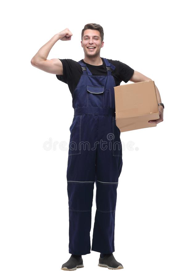 Strong worker in overalls with a large cardboard box. isolated on white royalty free stock photos
