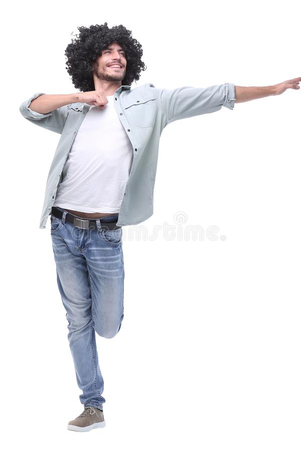 In full growth. stylish young man pointing to copy space royalty free stock image