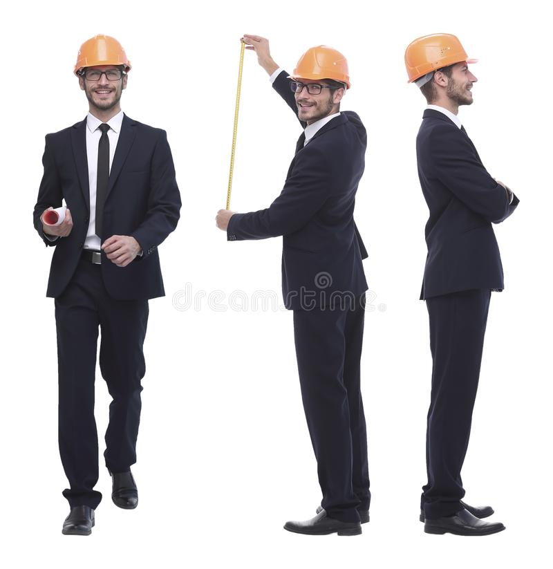 In full growth .successful architect engineer in orange helmet. royalty free stock photography